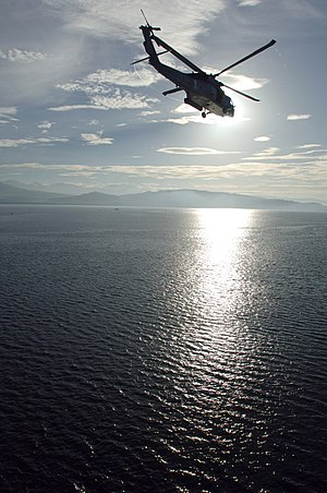 Illana Bay - A US Navy helicopter flies over the bay
