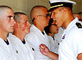 US Navy 080702-N-4565G-004 An upper-class Midshipmen instructs a Plebe from class 2012 on military bearing during Induction Day at the Naval Academy.jpg