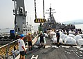 US Navy 080825-N-4044H-011 Lt. j.g. Robert Bailey and Boatswain's Mate Seaman Recruit Eddius Hucks guide a pallet of humanitarian assistance supplies on the weather deck aboard the guided-missile destroyer USS McFaul (DDG 74).jpg