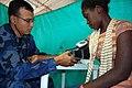 US Navy 090611-F-5647K-019 Lt Carlos Perez, a Nicaraguan navy doctor aboard hospital ship USNS Comfort (T-AH 20) checks a Colombian patient's blood pressure.jpg