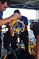 US Navy 090805-N-4220R-008 A Royal Brunei Navy diver is fitted with a KM-37 dive helmet by members of U.S. Navy Mobile Diving and Salvage Unit (MDSU) 1 during training aboard the Navy Sealift Command rescue and salvage ship USN.jpg