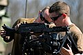 US Navy 100319-N-3136P-127 Hospital Corpsman 2nd Class Rocky Gann assists Gunner's Mate Seaman Rob Lotton, both assigned to Riverine Squadron (RIVRON) 1, assemble an M240 automatic machine gun during a six-day field exercise at.jpg