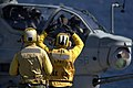US Navy 100524-N-6477M-251 Aviation Boatswain's Mate Airman Apprentice Micah Bogstadt, right, shadowed by Aviation Boatswain's Mate Airman Rodney Crowley, gives the signal for lift off to an AH-1Z Super Cobra.jpg