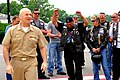US Navy 100528-N-8366W-092 Capt. Daniel Zinder, deputy commander of National Naval Medical Center, welcomes Rolling Thunder participants to National Naval Medical Center to ride through hospital grounds in honor of recovering v.jpg