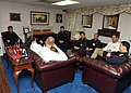 US Navy 101209-N-0939H-002 Capt. David Lausman speaks with members of the Japan Maritime Self-Defense Force prior to a dinner celebrating the wrap.jpg