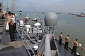 US Navy 110307-N-6692A-097 Sailors and Marines man the rails as USS Germantown (LSD 42) pulls away from the pier after a port visit in Indonesia.jpg