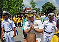 US Navy 110512-N-XX999-127 Rear Adm. Thomas Carney, commander of Task Force 73, returns a boy's traditional Thai greeting.jpg
