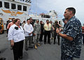 US Navy 110715-N-QD416-227 Commodore Brian Nickerson, mission commander of Continuing Promise 2011, explains the flight deck of Military Sealift Co.jpg