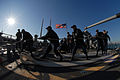 US Navy 111128-N-DU438-131 Sailors aboard the guided-missile cruiser USS Gettysburg (CG 64) heave around on a line on the fantail as the ship gets.jpg