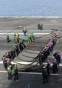 US Navy 120204-N-VA840-004 Sailors participate in a barricade drill on the flight deck of the aircraft carrier USS George H.W. Bush (CVN 77).jpg