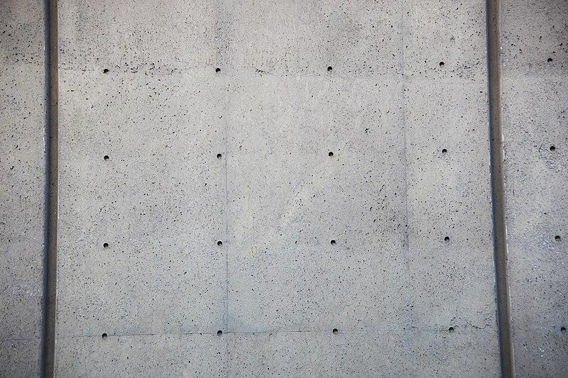 Unused cladding holes - east facade - J Edgar Hoover Building - Washington DC - 2012.jpg