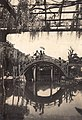 Viewing the Wisteria on Taiko Bridges in Kameido Tenjin Shrine, Kameido, Tokyo (藤見物, 亀戸天神社 太鼓橋, 東京都江東区亀戸) (1914-09 by Elstner Hilton) clipped.jpg