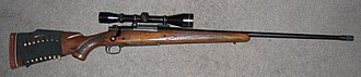 Winchester Model 70 - Winchester Model 70 with rifle scope and 24-inch barrel. One-piece scope mount.