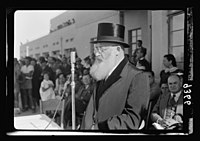 Wings over Palestine-Certificates of Flying School, April 21, 1939. Dr. Herzog, Chief Rabbi of Palestine (Askenazim) addressing gathering thro(ough) loudspeakers (Lydda Air Port) LOC matpc.18310.jpg