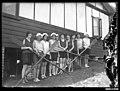 Women with rowing oars, Sydney (8262078889).jpg