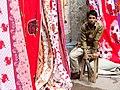 Young Man at Fabric Stall - Old City - Dhaka - Bangladesh (12831210125).jpg