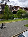 (one person riding a bike by a river in Cuenca, Ecuador.jpg