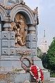 Памятник гренадерам, павшим под Плевной, с высотным зданием на заднем плане.jpg