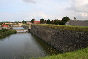 Gravelines - The moat, the drawbridge, the western walls and the bastion of the Mill