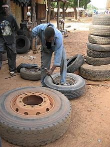 1917282-Soma the repairing of the tyre-The Gambia.jpg