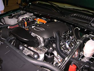 Hybrid vehicle drivetrain - Engine compartment of a 2006 GMC Sierra Hybrid.
