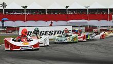 M.Schumacher pilote un kart rouge et blanc au Desafio Internacional das Estrelas 2007.