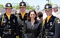 ATTORNEY GENERAL HARRIS STANDS WITH HONOR GUARD.jpg