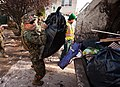 A Marine hoists a bag of trash into the back of a garbage truck in Staten Island, N.Y., on Nov 121105-M-PH073-104.jpg