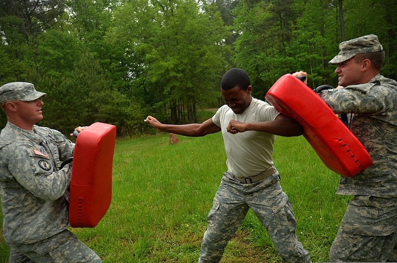 File:A U.S. Soldier, center, assigned to the 1132nd Military Police Company, North Carolina Army National Guard makes his way through a defense course during oleoresin capsicum familiarization training at Camp 130501-Z-AY498-020.jpg
