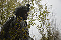 A U.S. Soldier with Iron Troop, 3rd Squadron, 2nd Cavalry Regiment watches for simulated enemy movement as part of a decisive action training environment exercise 121025-A-LE273-024.jpg