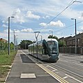 A city-bound tram leaving Meadows Way West (geograph 4632616).jpg