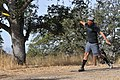A disc golfer tees off during the Professional Disc Golf Association's Norcal Series Championships.jpg