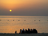 A family of saudis at khobar half moon beach (2931856166).jpg