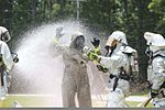A member of the Marine Corps Air Station Beaufort fire department is washed as he goes through a decontamination center at the sight chemical spill at the training pool at Marine Corps Air Station Beaufort 130719-M-VR358-089.jpg