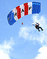 A parachutist from the Royal Air Force's Falcons Display Team, guides himself safely back to terra firma following a display MOD 45147930.jpg