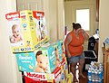 A resident packs diapers and water in her Naval Air Station Key West. (36272614123).jpg