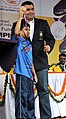 """A young sports person of """"Come & Play Scheme"""" of Sports Authority of India, after presenting the cheque of Special Cash Award to Shri Gagan Narang, the Medal winner of London Olympics 2012, at the felicitation function.jpg"""