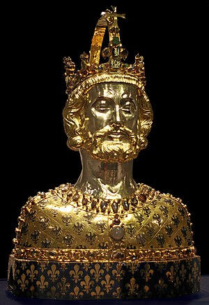 Symbols of Europe - Reliquary, golden bust of Charlemagne wearing the Imperial Crown of the Holy Roman Empire in Aachen Cathedral, with the German reichsadler embossed on the metal and the French fleur-de-lis embroidered on the fabric