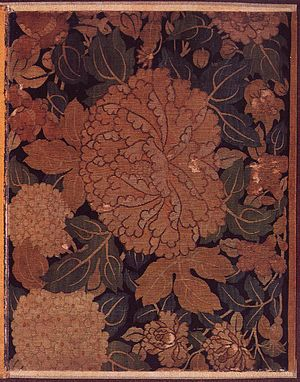 K'o-ssu - Song dynasty silk tapestry wrapper from the Admonitions Scroll of Gu Kaizhi, with a design of a peony among hydrangeas.