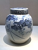 Tobe ware covered jar, grape and squirrel design, blue underglaze. Edo period, 19th century