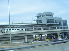 An AirTrain at Federal Circle viewed from a car window.
