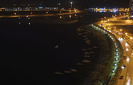 Night view of the boats docked to the east shorline of Al Khan Lagoon.