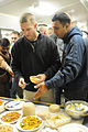An Indian Army soldier offers sweets to Maj. John Hill during a Diwali celebration at the Wilderness Inn dining facility on Joint Base Elmendorf-Richardson, Alaska.jpg