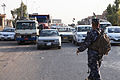 An Iraqi policeman with the emergency services unit signals a car to approach a checkpoint in Kirkuk province, Iraq, Aug. 1, 2011 110801-A-YF193-025.jpg