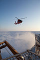 An MH-65 Dolphin helicopter crew assigned to Air Station Kodiak, Alaska, forward deployed aboard USCGC Healy (WAGB-20), hovers off the Bering Sea ice about 67 miles south of Nome, Alaska, Jan 120111-G-ZZ999-004.jpg
