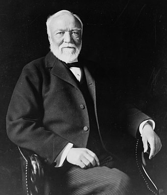 Scottish-born American industrialist and philanthropist Andrew Carnegie Andrew Carnegie, three-quarter length portrait, seated, facing slightly left, 1913.jpg
