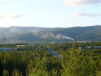 Kola Alkaline Province - Outskirts of the town Apatity where mining of apatite ore from the Kola alkaline Province is the main economic activity. In the background is the Khibiny Mountains, a giant and protuding body of nepheline syenite.
