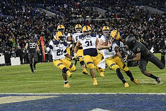 Zach Abey - Abey fights off a tackle as he reaches the end zone in the 2016 Army–Navy Game
