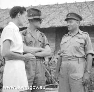 Agnes Newton Keith - Agnes Newton Keith (left) speaking with Major T. T. Johnson, 2/6 Field Park Company (centre) and Brigadier T. C. Eastick (right), Commander of the Kuching Force of the Australian 9th Division, shortly after the Australians liberated the camp at Batu Lintang, Kuching on 11 September 1945.
