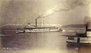 Bailey Gatzert (sternwheeler) - Bailey Gatzert at Seattle circa 1891, with the Olympic Mountains visible in the distance